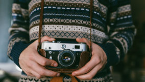 Man holding old retro camera in hands Stock Photos