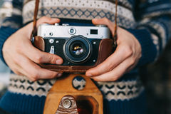 Man holding old retro camera in hands Stock Images