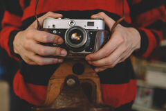 Man holding old retro camera in hands Stock Image