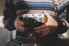 Man holding old retro camera in hands Royalty Free Stock Image