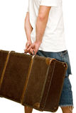 Man holding an old suitcase Stock Photos