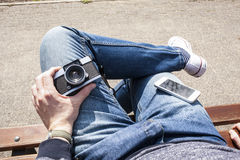 Man holding old vintage camera in hand Stock Photography