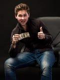 Man holding one hundred dollar bill Stock Image