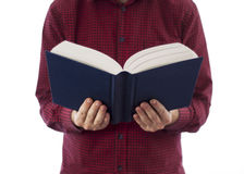 Man holding open book isolated on white. Man holding large open book with blank cover, isolated on a white background royalty free stock images