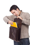 Man holding an open briefcase Royalty Free Stock Photography