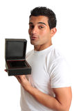 Man holding open gift box jewelry case Royalty Free Stock Images