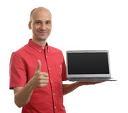 Man holding an open laptop Royalty Free Stock Photo