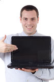 Man holding open laptop showing it with a smile Royalty Free Stock Photos