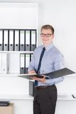 Man is holding openend file in the office Royalty Free Stock Photography