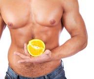 Man holding an orange Stock Photography