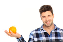 Man holding an orange. Happy man holding orange in his hand Stock Image