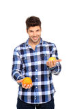 Man holding orange and lemon. Handsome man portrait with a orange and lemon in his hands Stock Photography