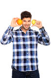 Man holding orange and lemon. Handsome man portrait with orange and lemon in his hands Royalty Free Stock Photo