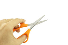 Man holding orange stainless steel scissors isolated Stock Image