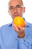 Man holding an orange. Up close Royalty Free Stock Photos