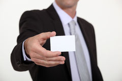 Man holding out business card Royalty Free Stock Image