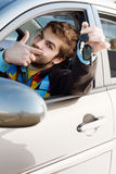 Man holding out car keys Stock Photo