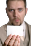 Man holding out card Royalty Free Stock Photo