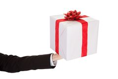 Man holding out a decorative gift Stock Image
