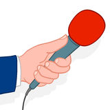 Man holding out a microphone Royalty Free Stock Photo