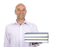 Man holding out a pile of books Royalty Free Stock Photos