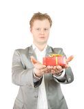 Man holding out a red present box Royalty Free Stock Image