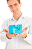 Man holding out a turquoise blue gift Royalty Free Stock Photography