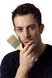 Man holding a paint brush Royalty Free Stock Photography