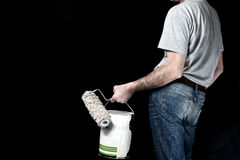 Man holding paint roller and a bucket of paint Royalty Free Stock Photography