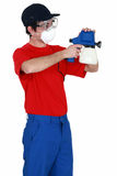 Man holding paint sprayer Stock Photography
