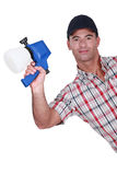 Man holding paint sprayer Stock Photos