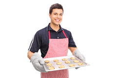 Man holding a pan full of chocolate chip cookies Stock Photos