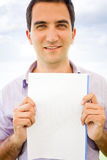 Man holding a paper Royalty Free Stock Image