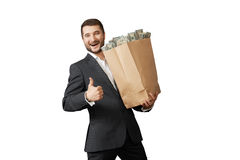 Man holding paper bag with money Stock Image