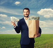 Man holding paper bag with money Royalty Free Stock Photo