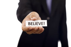 Man Holding Paper With Believe Text Royalty Free Stock Image
