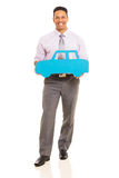 Man holding paper car Royalty Free Stock Photos