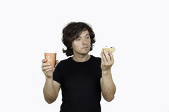 A man holding a paper coffee cup and cakes on a white background Royalty Free Stock Images