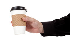 Man holding a paper coffee cup on white Stock Images