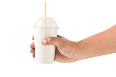 Man holding a paper cup with tube isolated over white background Royalty Free Stock Photo