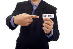 Man Holding Paper With Get Rich Text. Isolated over white background royalty free stock photos