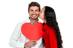 Man holding paper heart and being kissed by girlfriend Stock Image