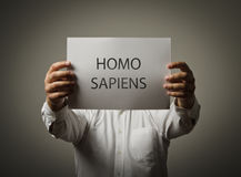 Man is holding a paper is his hands. Homo sapiens. Royalty Free Stock Photo