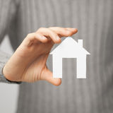 Man holding paper house Stock Photos