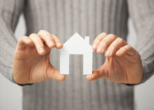 Man holding paper house Stock Photo