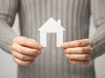 Man holding paper house Royalty Free Stock Image