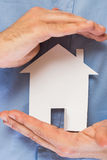 Man holding paper house in his hands Royalty Free Stock Photos