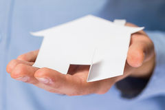 Man holding paper house in his hands Royalty Free Stock Image