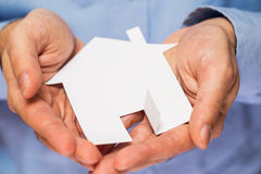 Man holding paper house in his hands Royalty Free Stock Photo