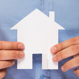 Man holding paper house in his hands Stock Photography
